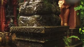 slow motion. statue fountain in asian style