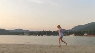 slow motion. woman runs along the beach of a tropical island