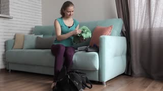 Sports Girl Collects Things For Training at Home