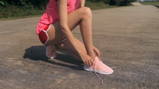 sports girl laces running shoes