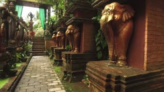statues of elephants in a park in Asian style