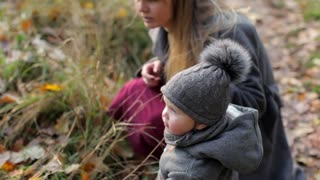 stylish little girl with mom in autumn park