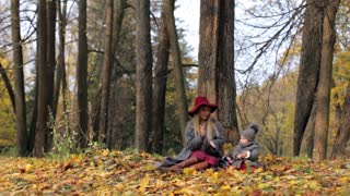 stylish mom with baby in autumn park