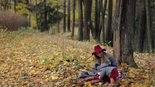 stylish mommy with daughter in autumn park