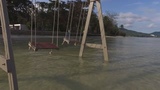 swing on the water near a tropical beach