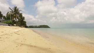 The deserted sunny beach of the island in Thailand
