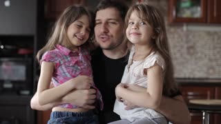 Two Girls Daughter Kiss and Hug Dad, Family Love