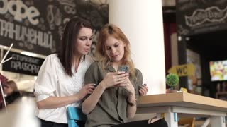 Two Woman Friends Fun Chatting in a Cafe