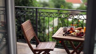 useful breakfast of fruits on the terrace of the villa