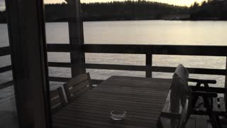 view from the terrace of a house on the water on a lake at dusk