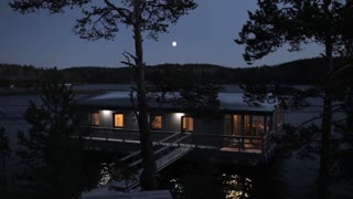 view of the house on the lake at night