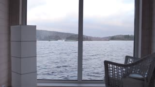 view of the lake from the window of the house