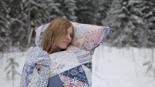 Woman in a Blanket and With a Pillow Sleeping in the Winter Forest