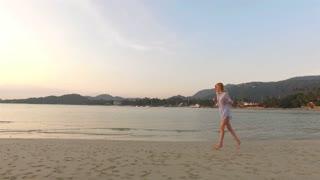 woman runs along the beach of a tropical island