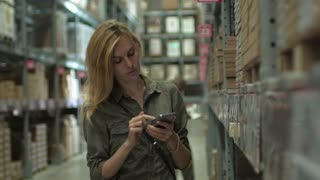 woman shopping on phone in store stock