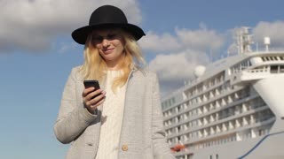 Woman Traveler With Phone in the Sea Cruise Liner