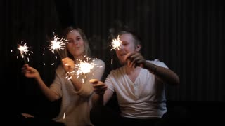 Young Loving Couple Celebrating With Sparkler