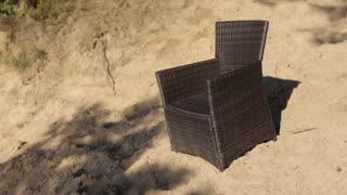 Wicker Chair on a Sandy Beach
