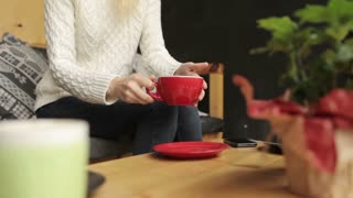 Woman Drinking Coffee While Sitting in a Cafe
