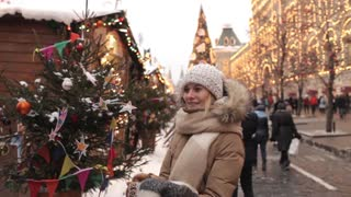 Woman Looks at Christmas Market on the Red Square, Moscow