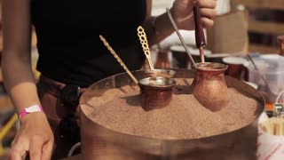 Woman Prepares Turkish Coffee on the Hot Sand
