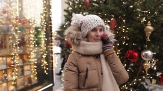 Woman Talking on the Phone at the Christmas Tree