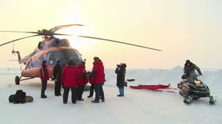 A group of tourists is preparing to fly to the North Pole on the Helicopter MI-8.