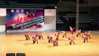 A Group Of Young Women Fiery Dance Sports Acrobatic Rock-N-Roll Formation.