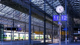 A passenger train arrives at the railway station in Helsinki, Finland. Time Lapse.
