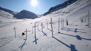 Abandoned cemetery on Spitzbergen. Many white crosses on the site of an old abandoned cemetery.