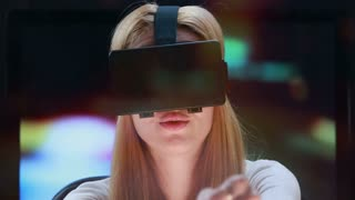 Car simulator using virtual reality technology. Young woman with pleasure uses head-mounted display.