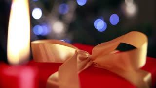 Christmas theme. Christmas gift with candles and twinkling lights.