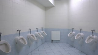 Empty Mens Toilet With Row Of Urinals