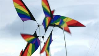 Garden winds. Colorful windmills spinning in the wind.