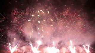 Grandiose celebratory fireworks in the night sky.