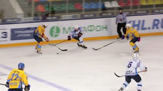 Great Shot on goal! Forward drives towards goal and scores! Ice hockey match