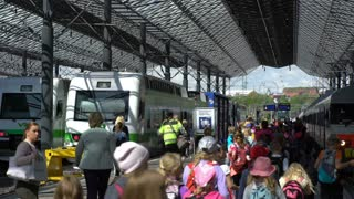 HELSINKI, FINLAND - MAY 24, 2016: Many passengers and trains at the railway station in Helsinki, Finland. Time Lapse.
