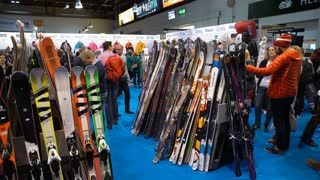 HELSINKI, FINLAND - NOVEMBER 04, 2016: Many buyers choose ski and snowboard equipment during the show DIGIEXPO 2016 in Messukeskus Expocenter.