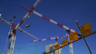 High-rise construction cranes in action on the outskirts of Helsinki. Time Lapse.