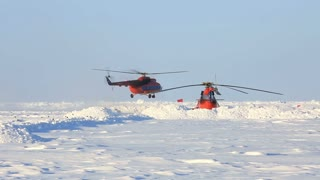 "ICE CAMP ""BARNEO"", NORTH POLE, ARCTIC - APRIL 10, 2015: Helicopters MI-8 take to the skies."