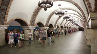 KIEV, UKRAINE - JULY 27, 2014: Crowd goes from cars at a metro station in Kiev.