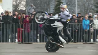 KIEV, UKRAINE - MARCH 15, 2013: World champion stunt riding Chris Pfeiffer performs in Kiev at the motor exhibition.