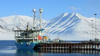 LONGYEARBYEN, SPITSBERGEN, NORWAY - 08 APRIL, 2015: Loading cargo on a cargo ship in port on Svalbard.