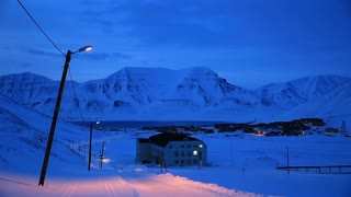 LONGYEARBYEN, SPITSBERGEN, NORWAY - APRIL 03, 2015: A small town in the far north of Europe among the snow-capped mountains at night.