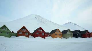 LONGYEARBYEN, SPITSBERGEN, NORWAY - APRIL 03, 2015: Snowmobile in a small Norwegian town in the far North.