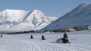 LONGYEARBYEN, SPITSBERGEN, NORWAY - APRIL 07, 2015: The caravan of snowmobiles sent an expedition to the far north.