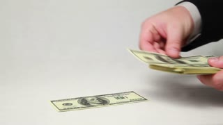 Male hands counting money on white background.