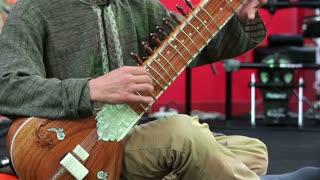 Man playing the sitar. Close-up.