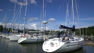 Many sailboats in the marina on the southern coast of Finland. Moving camera.