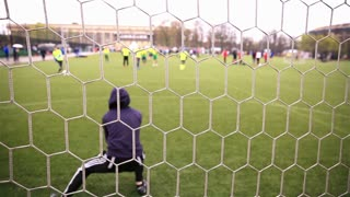 MOSCOW, RUSSIA - APRIL 01, 2015: Goalkeeper beats off the attack of the enemy team. Tournament on mini-football during the opening of the summer season in the sport center